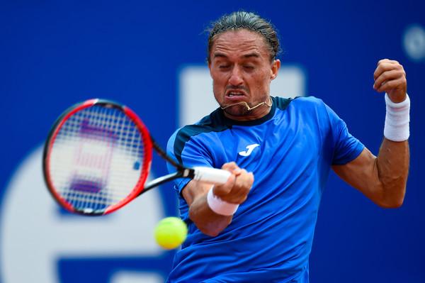 Alexandr Dolgopolov hits a forehand. Photo: David Ramos/Getty Images