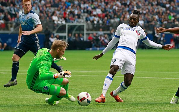 Dominic Oduro (in white, right). March 6th, 2016. Photo credits: Jeff Vinnick / Getty Images Sport