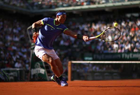 Rafael Nadal stretches for a shot (Photo: Julian Finney/Getty Images)