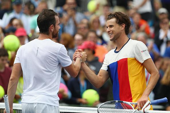 Adrian Mannarino congratulates Dominc Thiem on his win (Photo: Al Bello/Getty Images)
