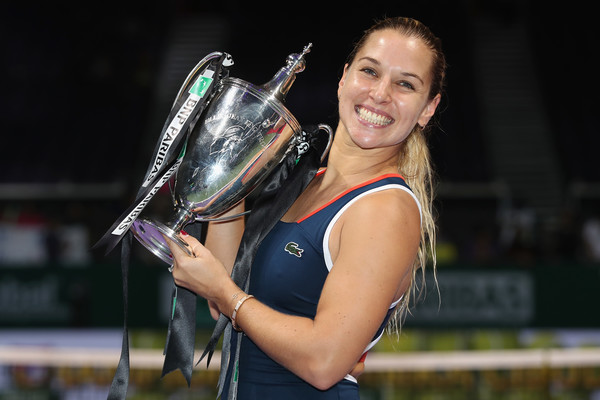 Dominika Cibulkova poses with the winner's trophy after defeating Angelique Kerber in the final of the 2016 BNP Paribas WTA Finals Singapore presented by SC Global. | Photo: Matthew Stockman/Getty Images