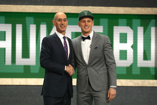 Donte DiVincenzo poses with NBA Commissioner Adam Silver |Mike Stobe/Getty Images North America|