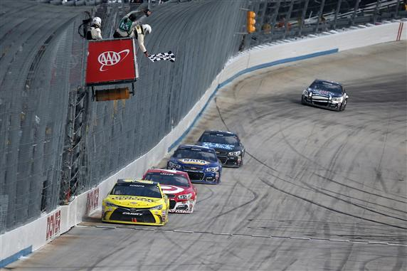 Kenseth takes the checkered flag last year. (Sean Gardner/Getty Images)