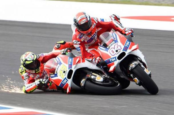 Oh no! Iannone crashes into his team-mate | Photo: AFP