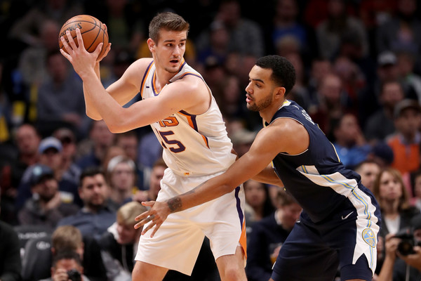 Dragan Bender #35 of the Phoenix Suns is guarded by Trey Lyles #7 of the Denver Nuggets. |Matthew Stockman/Getty Images North America|