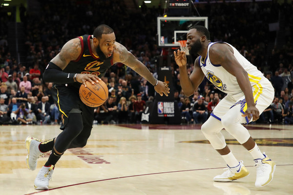 LeBron James #23 of the Cleveland Cavaliers drives against Draymond Green #23 of the Golden State Warriors during Game Three of the 2018 NBA Finals at Quicken Loans Arena.  Gregory Shamus/Getty Images North America 