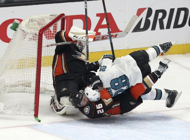 The San Jose Sharks fought the Anaheim Ducks even in the goal crease to take Game 1. (AP Photo/Reed Saxon)