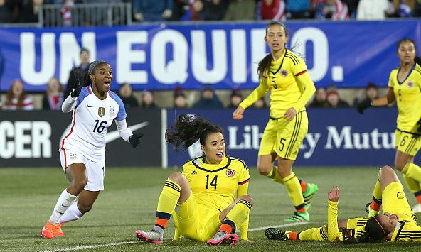 Lori Chalupny #16 of the United States celebrates her goal as Nataly Arias #14 of Colombia reacts during an international friendly soccer match at the Pratt & Whitney Stadium on April 6, 2016 in East Hartford, Connecticut. (Photo by Jim Rogash/Getty Images