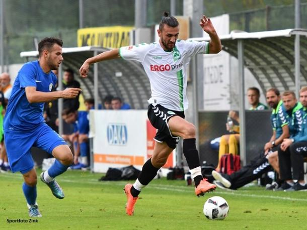 Dursun in action during a pre-season friendly. | Image credit: Sportfoto Zink