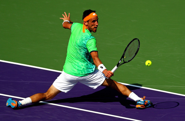 Damir Dzumhur extends for a backhand. Photo: Clive Brunskill/Getty Images