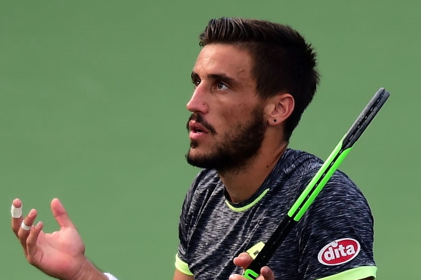 Photo: Jared C. Tilton/Getty Images- Damir Dzumhur expresses his frustration early.
