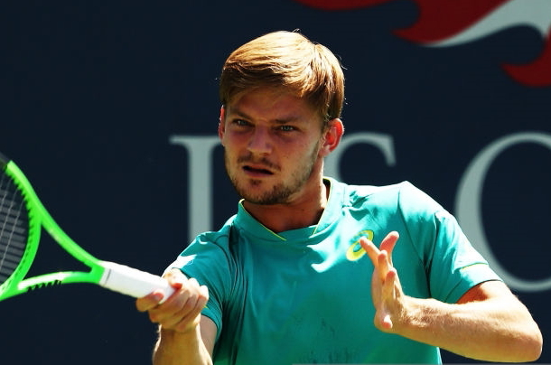 Photo: Elsa/Getty Images- David Goffin hits a forehand winner