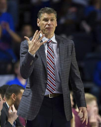 Loyola head coach Porter Moser sginals to his team during the Rambler