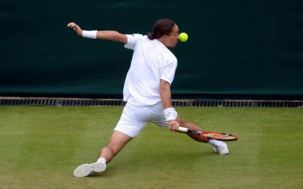 Dolgopolov sliding into a backhand | photo: The Telegraph