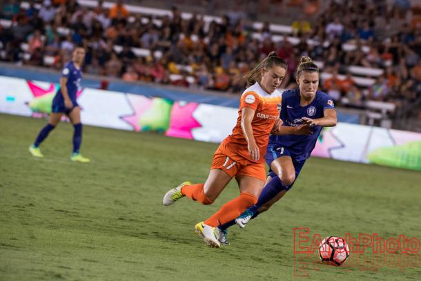 Houston Dash and Brazilian midfielder, Andressinha, battling with Orlando Pride and Austraalian defeneder, Steph Catley. l Photo: EarchPhoto
