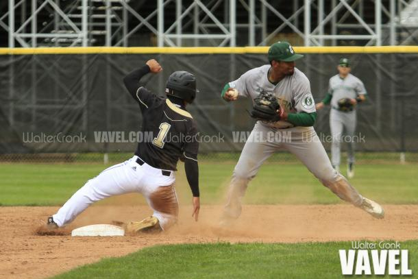 Marquise Gill (4) of Eastern Michigan gets the force out at 2nd base. Photo: Walter Cronk
