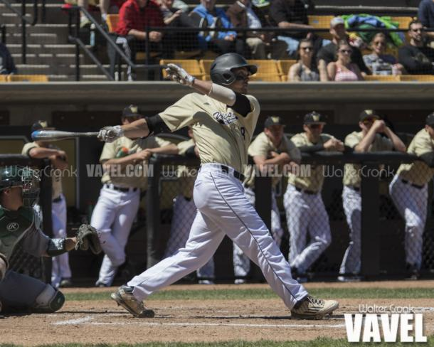 Tanner Allison (8) hits an RBI single to score the first run of the game. Photo: Walter Cronk