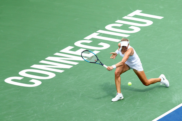 Ekaterina Makarova retrieves a backhand during the match | Photo: Maddie Meyer/Getty Images North America