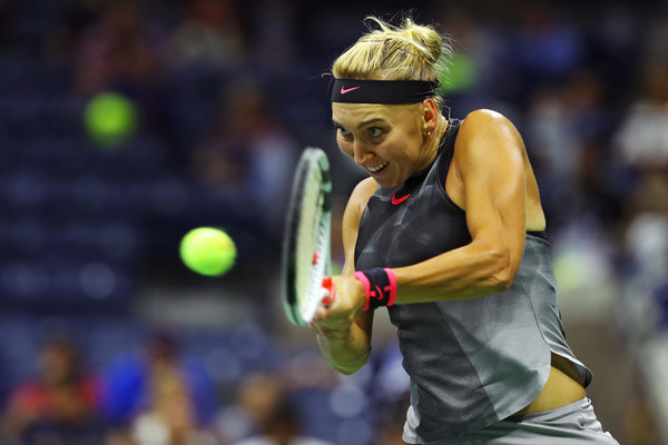 Elena Vesnina hits a backhand | Photo: Richard Heathcote/Getty Images North America