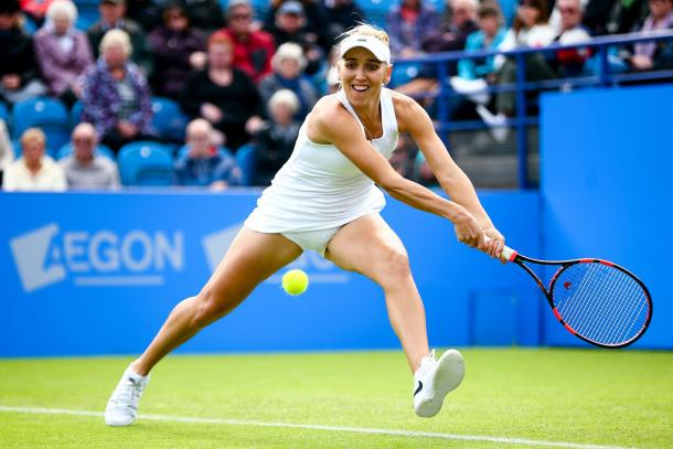 Elena Vesnina hitting a backhand. | Photo: Jordan Mansfield/Getty Images