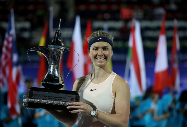 Elina Svitolina poses alongside her second Dubai title | Photo: Francois Nel/Getty Images Europe