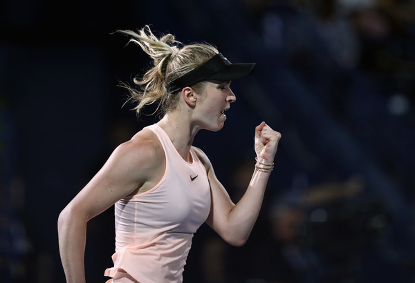 Elina Svitolina celebrates after winning match point to claim the title