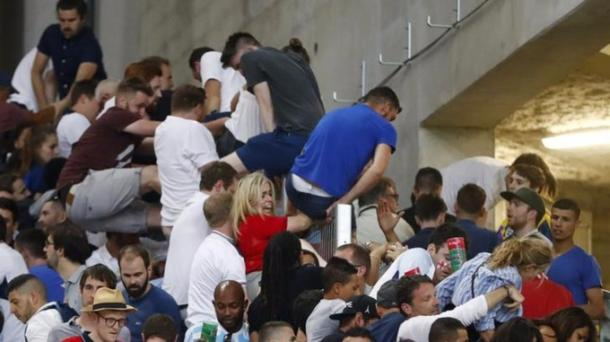 England fans fleeing Russian fans, as chaos ensued inside the Stade Velodrome / ITV