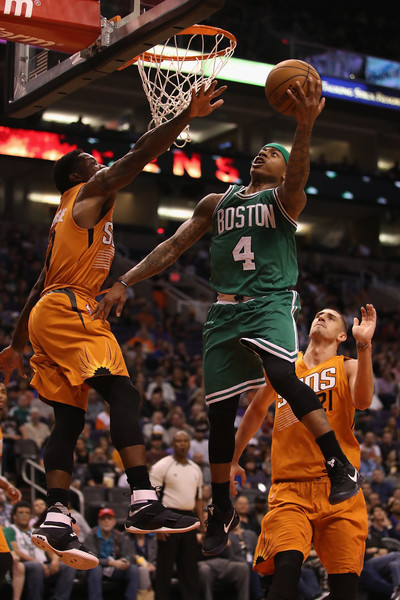 Isaiah Thomas #4 of the Boston Celtics lays up a shot past Eric Bledsoe #2 of the Phoenix Suns. |Source: Christian Petersen/Getty Images North America|