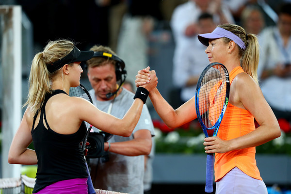 Maria Sharapova and Eugenie Bouchard meet for a handshake at the net | Photo: Clive Rose/Getty Images Europe