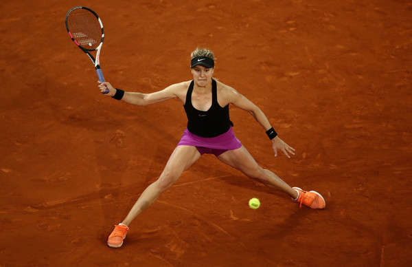 Eugenie Bouchard stretches to hit a defensive forehand during her second-round match against Maria Sharapova at the 2017 Mutua Madrid Open. | Photo: Julian Finney/Getty Images