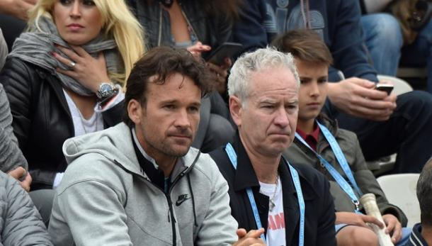 Carlos Moya (left) and John McEnroe watch Milos Raonic play at the 2016 French Open. Photo: Getty Images