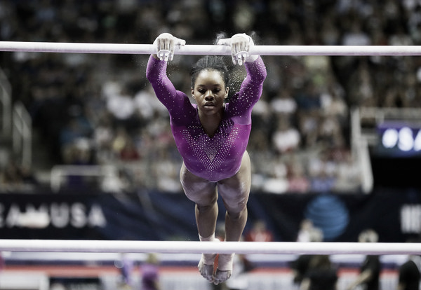Gabby Douglas performs her best event, uneven bars, at the Olympic Trials. Photo Credit: Ezra Shaw of Getty Images