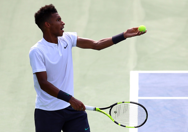 Félix Auger-Aliassime tosses up a serve during his Rogers Cup debut on Tuesday in Toronto. Photo: Getty Images