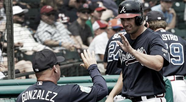 Fred Gonzalez high-fives Jeff Francouer during a spring training game in March. (John Raoux/AP)
