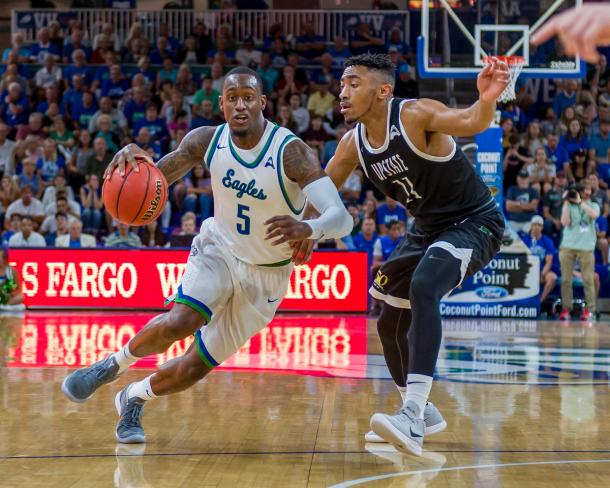 Johnson drives past USC Upstate's Deion Holmes during their Atlantic Sun quarterfinal last night/Photo: Linwood Ferguson/Florida Gulf Coast athletics website