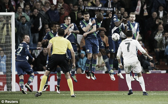 Above: Cristiano Ronaldo completes his hat-trick in Real Madrid's 3-0 win over Wolfsburg | Reuters