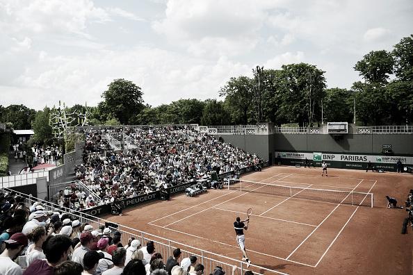 Spectators look on as John Isner battles Teymuraz Gabashvili at the 2016 French Open. (Photo: Getty Images).