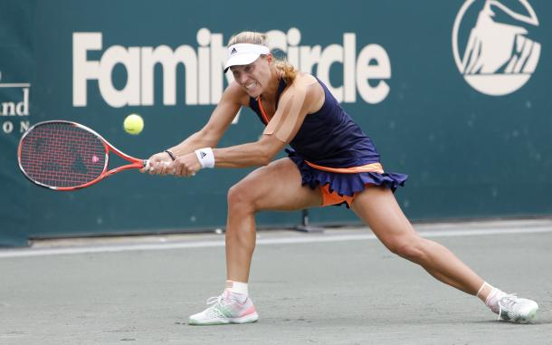 Angelique Kerber slides into a backhand at the Family Circle Cup in Charleston, South Carolina/Getty Images