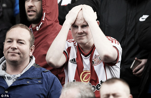 Above; Sunderland AFC fan left frsutrated after their 1-0 defeat to Stoke City | Photo: PA