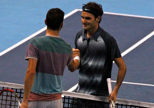 Dimitrov and Federer (facing) shake hands in Basel 2013. Photo: Marianne Bevis