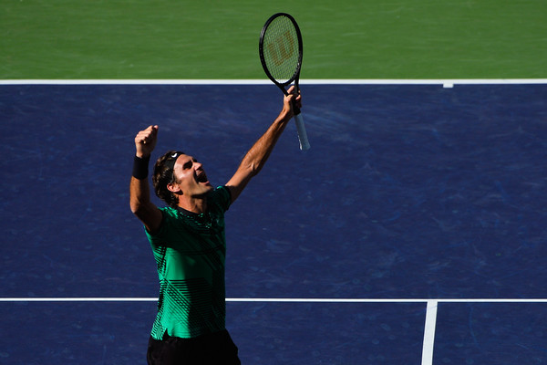 Federer celebrates immediately after converting his match point. Photo: Alex Goodlett/Getty Images