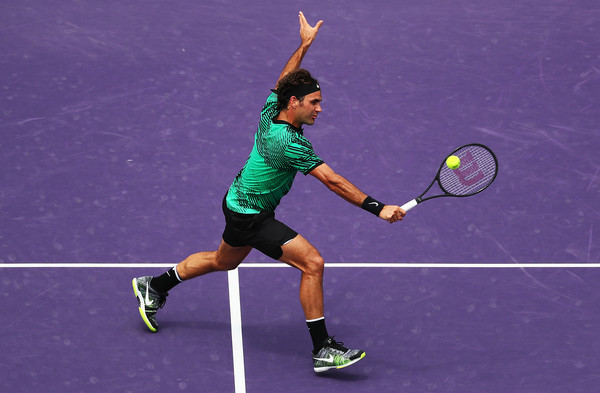 Federer hits a backhand volley during his finals victory. Photo: Al Bello/Getty Images