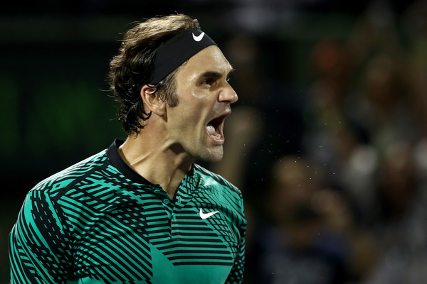 Federer reacts after defeating Nick Kyrgios in the semifinals. Photo: Julian Finney/Getty Images