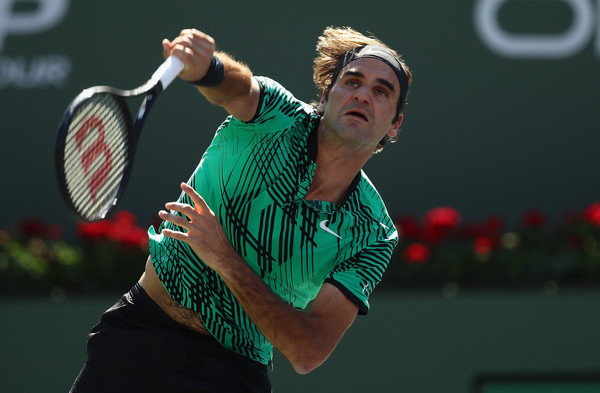 Federer serves during the final. Photo: Clive Brunskill/Getty Images