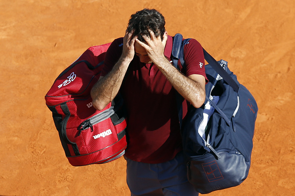 Roger Federer leaves the court frustrated after his loss in Monte Carlo. Photo: Valery Hache/AFP/Getty Images