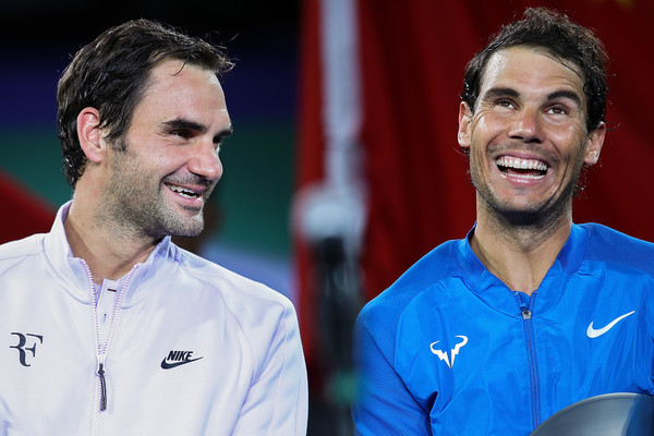 Federer and Nadal share a laugh after their Shanghai final last fall. Photo: Lintao Zhang/Getty Images