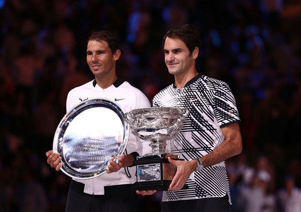 Federer and Nadal pose with their trophies after the Swiss was victorious in the Australian Open final. Photo: Scott Barbour/Getty Images