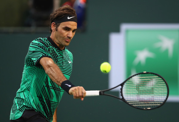 Federer hits a backhand during his quarterfinal win. Photo: Clive Brunskill/Getty Images