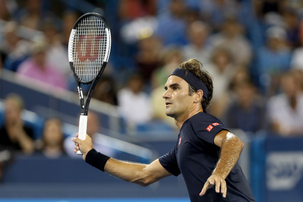 Federer lines up a volley. Things looked in doubt for the Swiss until he dominated the decider. Photo: Rob Carr/Getty Images