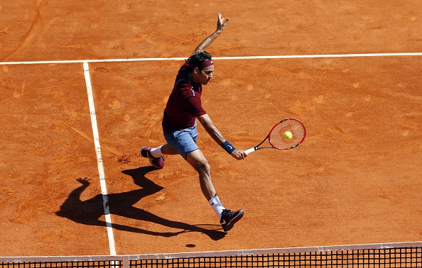 Roger Federer hits a backhand volley. Photo: Valery Hache/AFP/Getty Images